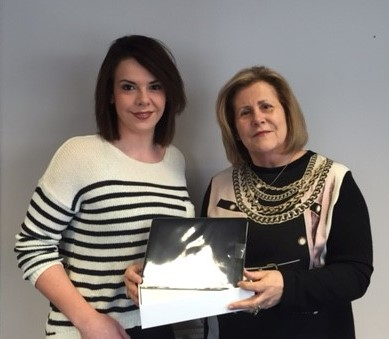 Carmel presenting Amy with her new iPad Air