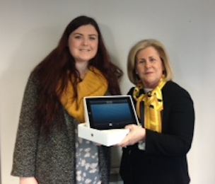 Carmel presenting Denise with her new iPad